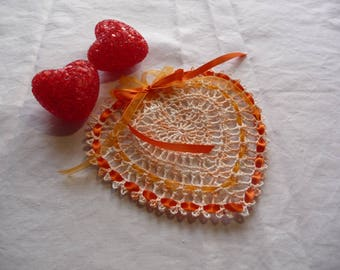 Crocheted cotton apricot ombre heart shaped doily.