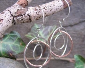 sterling and copper earrings . (( Hammered Globe )) . gyroscope-style dangle earrings . kinetic earrings . READY TO SHIP