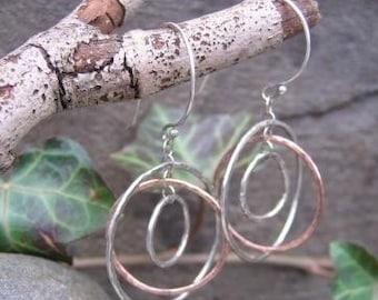 sterling and copper earrings . (( Hammered Globe )) . gyroscope-style dangle earrings . kinetic earrings . READY TO SHIP
