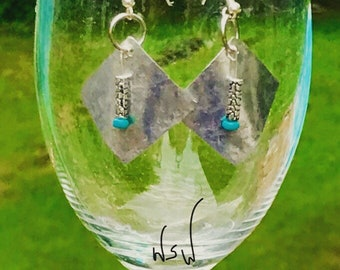 Beautiful hammered silver earrings. Hand cut and hammered.