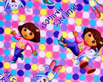 Dora the Explorer fabric, Dora and Boots fabric, Hispanic Bilingual girl fabric 100% cotton for Quilting and general sewing projects.
