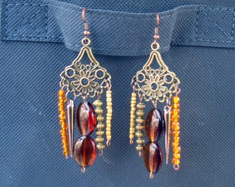 Vintage bronze and gold with various charms earrings