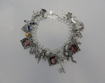 Harry Potter charm bracelet with Hermione Ron spell book hat wizard snitch and more Loaded with charms