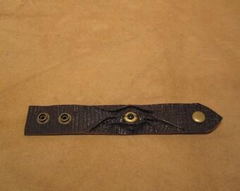 Grichels leather wrist cuff/bracelet - textured dark brown with gold eye