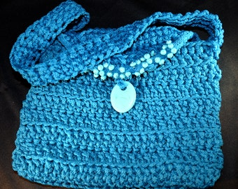 Crocheted Purse; turquoise poly nylon cord, poly silk lined and embelished with turquoise colored beads