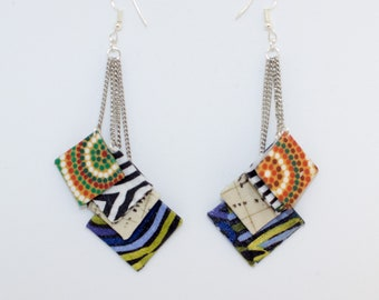 Earrings dangle multiple chains and squares of fabrics
