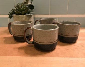 Five Gray Stoneware Coffee Cups