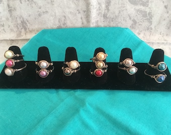 Imitation pearl wire wrapped rings.