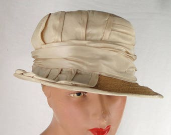 Early 20th Century  Woven Straw with Ivory Silk Trimmed Brimmed Hat  .  Edwardian . Early 1920's .