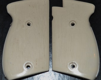 Astra Constable II 2 pistol grips Tan color woodgrain texture plastic