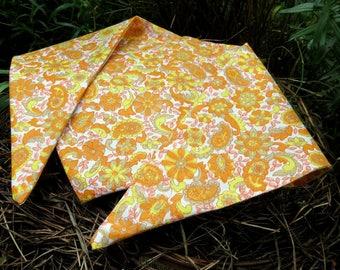 A dog bandana.  Size medium.  Groovy sixties flower power.  64cm x 23cm.