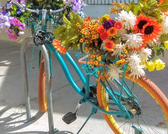 Island Transportation - Vintage Bicycle with Flower Basket and Bountiful Bouquet - Original Color Photograph by Suzanne MacCrone Rogers