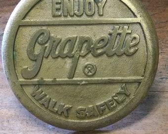 Vintage Grapette Soda Sidewalk Button