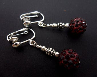 A pair of pretty burgundy red  shamballa style dangly clip on dangly earrings.