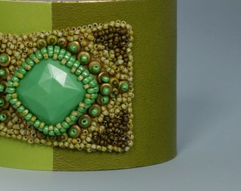Bead embroidery cuff bracelet. Pea, spring green, and chocolate brown cuff bracelet. Vintage glass cabochon.
