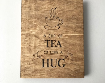 A cup of tea is like a hug - wood burned artwork - cuppa tea