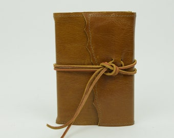 Refillable leather journal with wrapped cord closure