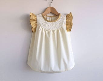 girls pale yellow dress with lace detail