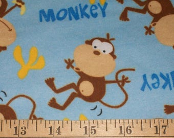 Monkeys with Bananas on Blue Flannel Fabric