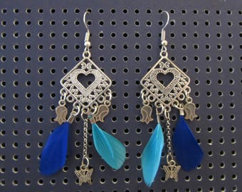 Earrings with blue feathers with roses and Butterfly charms