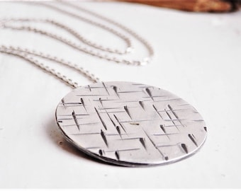 Long silver ' A Maze In ' pendant on diamond cut chain