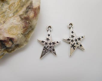 8 charms / star pendant silver 22x15mm