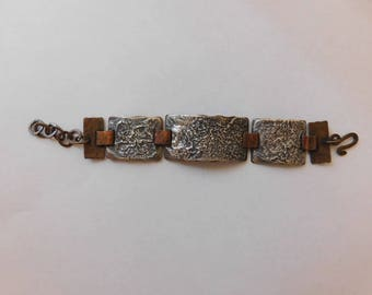 Rustic reticulated sterling silver and copper linked bracelet