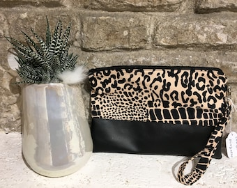 Black and pink Leoparadata leather clutch bag
