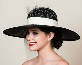 "SALE / 50% OFF Wide Brim Kentucky Derby Hat. White Embroidery on Black Sinamay Straw. Ivory Silk Taffeta Sash. Audrey Hepburn. 6"" brim"