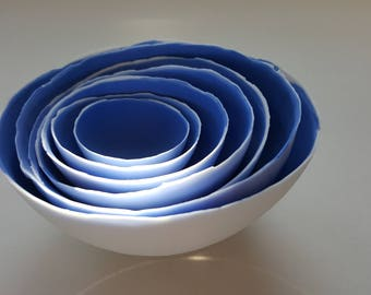 Set of 7 stoneware fine bone china nesting bowls in blue and white.