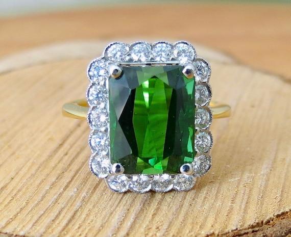 18K yellow gold 6 1/3 carat tourmailine and 2/3 carat diamond ring.