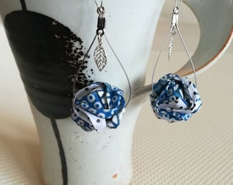 Blue origami paper ball earrings.
