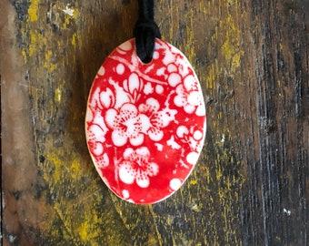 Porcelain oval pendant - red cherry blossom