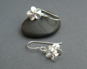 tiny sterling silver flower earrings. small plumeria dangle. leverback floral botanical nature gardener. drop earrings. simple jewelry gift