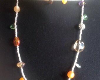 Long multi-beaded necklace including Swarovski elements