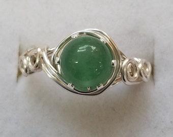 Wire wrapped ring with a semi precious aventurine gemstone.