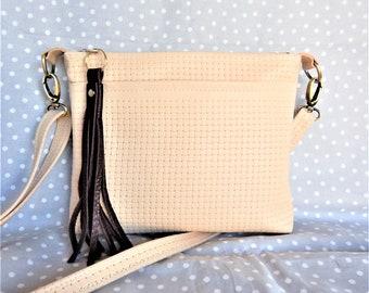Ivory basketweave leather crossbody bag, or cream color leather shoulder bag.