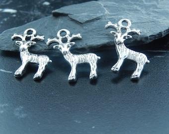 2 silver deer charms