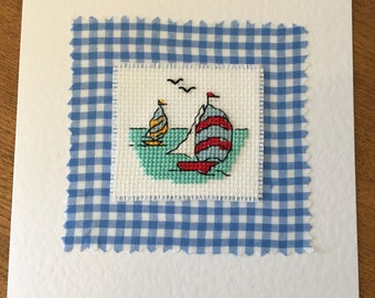 Beautiful handmade greetings card with cross stitched sailing boat design.