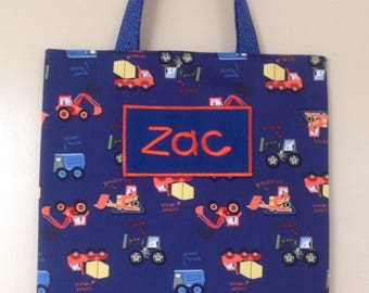 Personalised Library Bag-construction vehicles on a dark blue background.