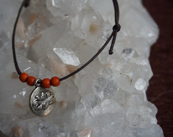 Charm bracelet - Lotus flower pendant with orange beads
