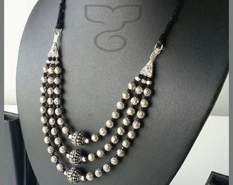 MC 1822310 Oxidised silver three stranded beaded necklace.