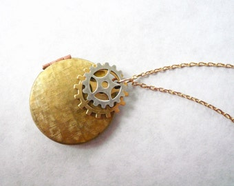 Bicycle gear locket necklace. Mixed metal steampunk locket necklace.