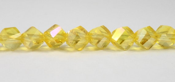 "Helix Crystal Beads 6mm Faceted Lemon Yellow AB Twisted Crystal Beads, Chinese Crystal Glass Polygon Beads on a 7 1/4"" Strand with 33 Beads"