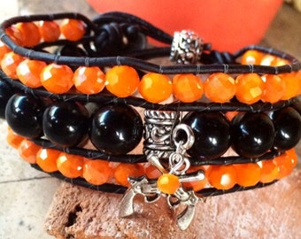 Handmade Beaded Cuff Bracelet, orange and black with pistol design, leather wrap