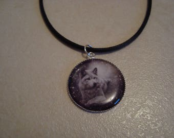 Boy with a Wolf pendant necklace