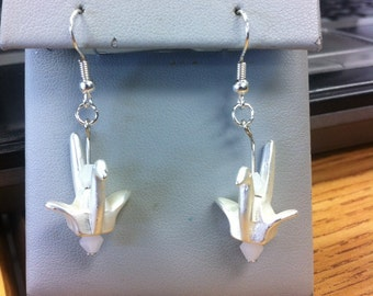 Acrylic origami-type cranes with two white bicone beads as earrings