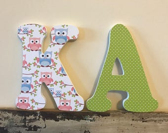 Cute Owl Themed wood letter wall hanging for a Nursery or girls room. Blue, green and pink.