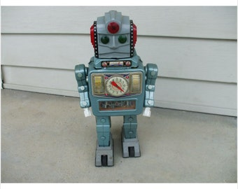 Alps Rocket Man in Space Armor Battery Operated Tin Robot 1963
