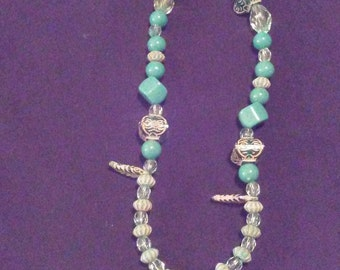 Plastic Beaded Necklace With Turquoise Colored Beads and Glass Pendant